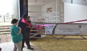 Cutting the ribbon - left to right Moorwards Farm owner Jodie Maile Noami Isaiah and Amy Caldwell.