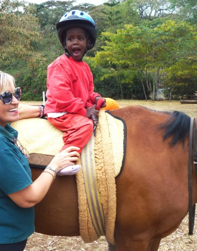 Disabled horse riders in UK and Africa say 'Hats off' to players of People's Postcode Lottery and British Airways
