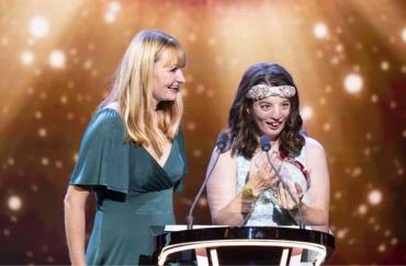 Natalie and Philippa accept their award